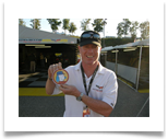 "Corvette Racing's Johnny O'Connell holds up ""The Unions"" sticker to honor Earl during the Petit Le Mans weekend at Road Atlanta 10/2/2008."